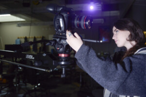 Picture is of film degree student working professional film equipment.